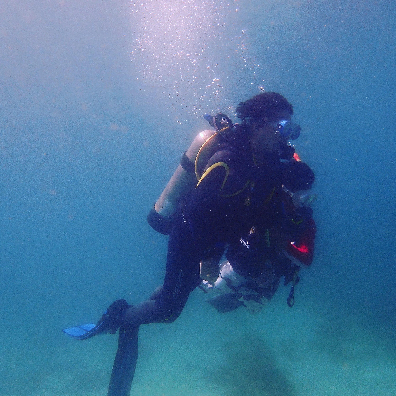 Me exploring the deep blue waters of Small La Laguna, Sabang, Puerto Galera. Photography by Pedro Magsino of Arkipelago Divers.